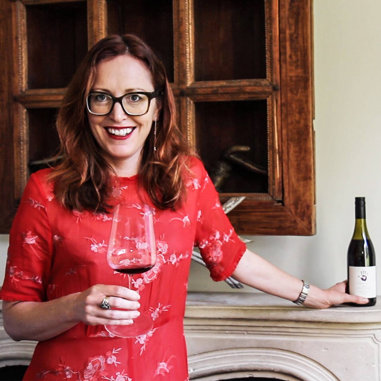 Tamra Kelly-Washington photographed with a glass of Seresin wine and bottle