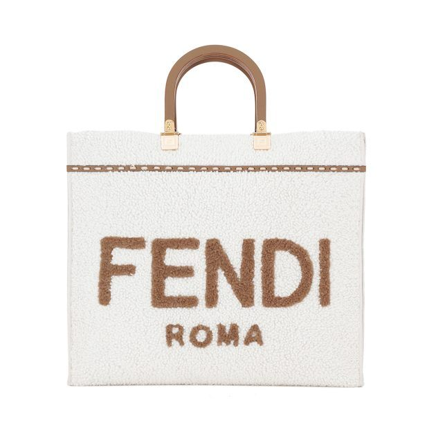 Fendi large cream colored tote with brown Fendi lettering, gold hardware and brown leather top handle