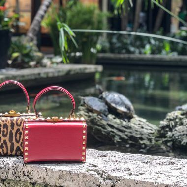 An array of Valentino Roman Palazzo box bags in red, black and leopard