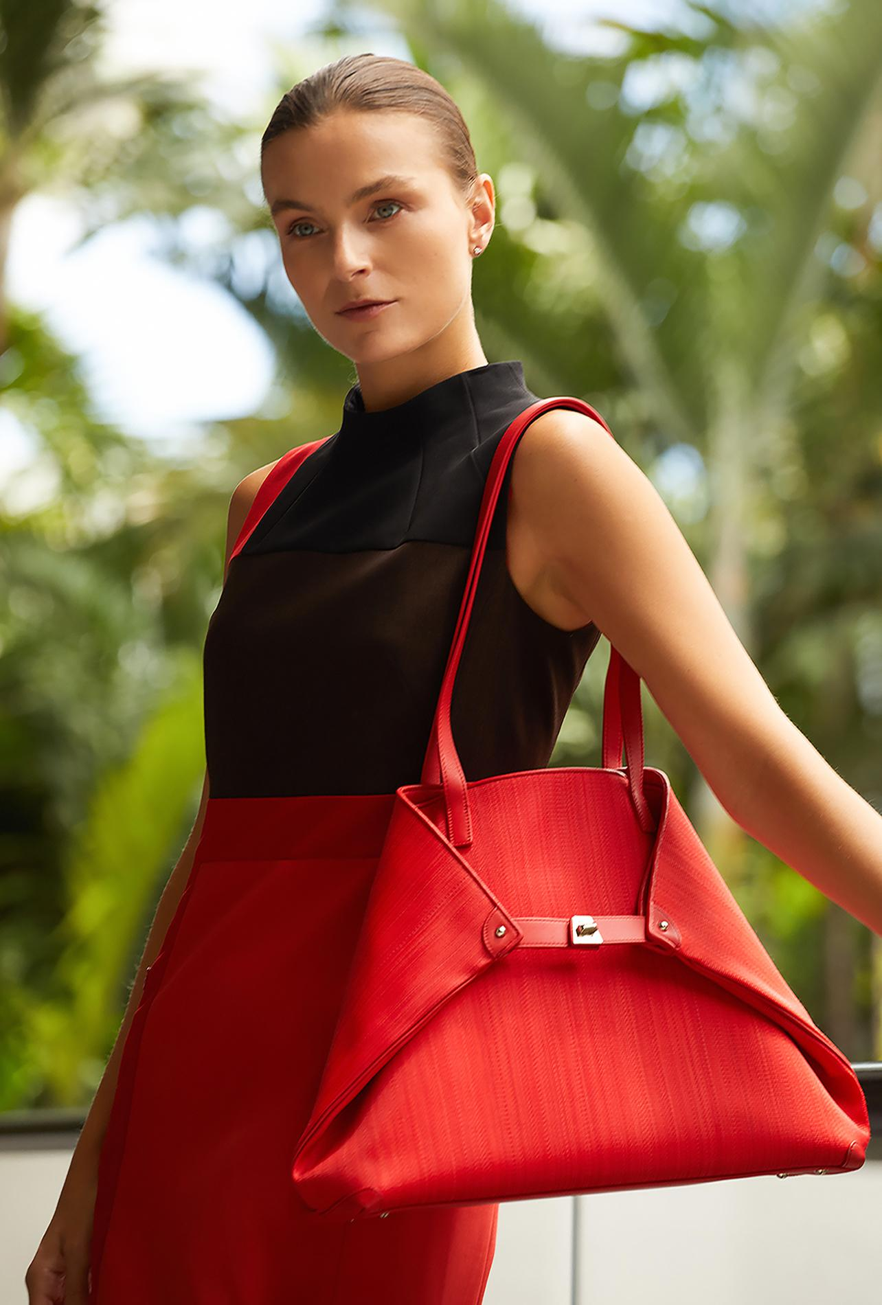 Akris red, orange and black patchwork wool dress and Ai red horsehair shoulder bag