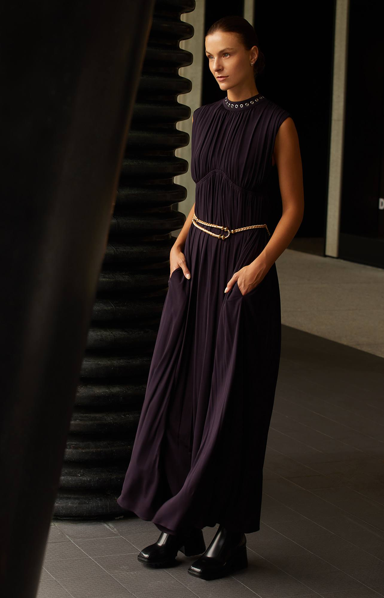 Chloé long sleeveless dress in black with silver neckline accents, brass and leather belt and black PVC rainboots