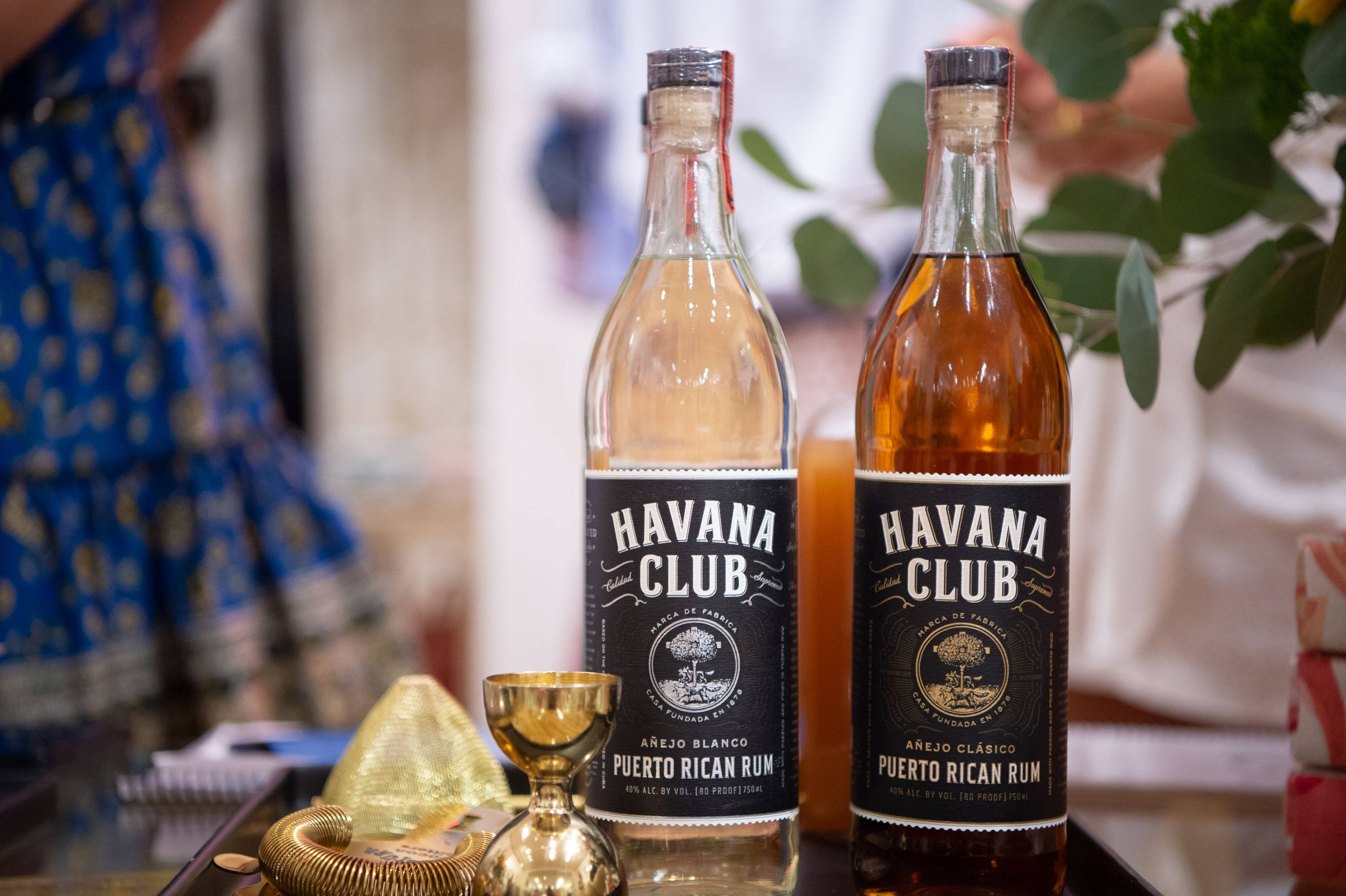 Havana Club Puerto Rican rum pictured with cocktail strainer and shot measuring cup