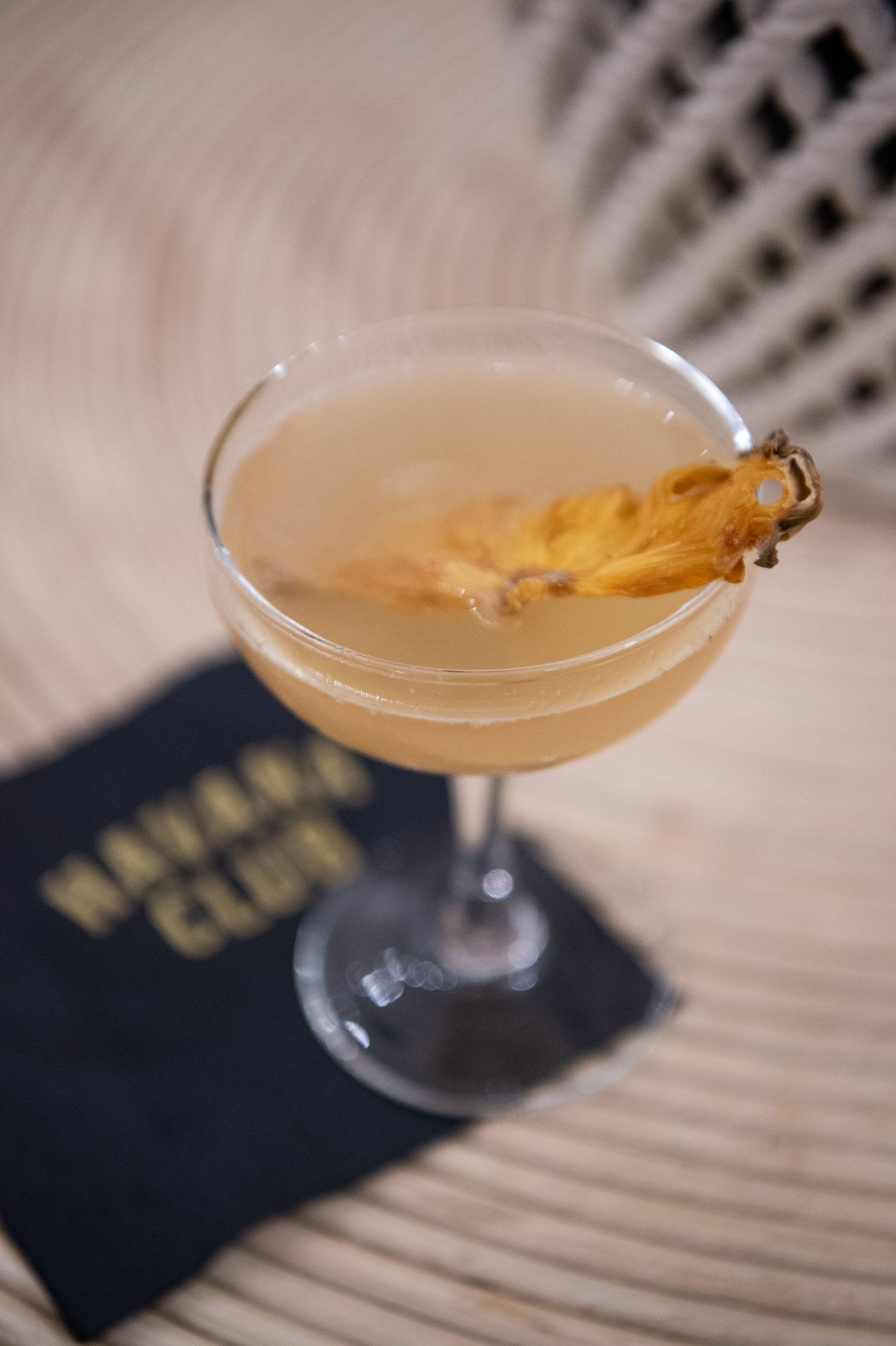 Rum cocktail with garnish photographed on a serving tray