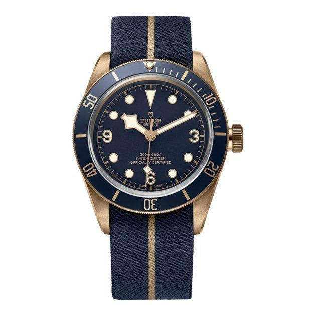 Tudor watch with a navy face, gold detailing and a navy woven wristband