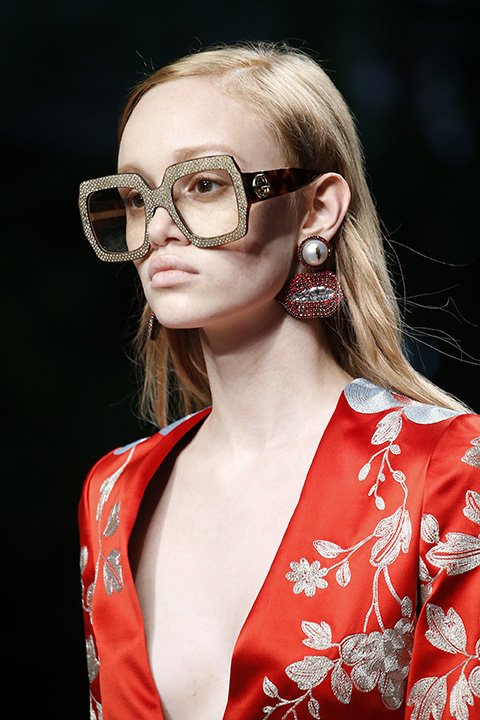Gucci goes for the intellectual ingénue look with its oversized shimmering eyewear